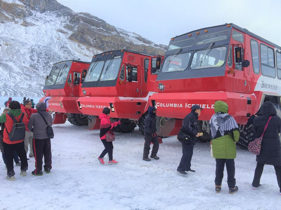 The huge Ice Explorer buses transport visitors to the Athabasca Glacier