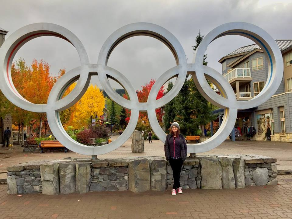 A Brummie Home and Abroad poses in front of the Olympic Rings in Whistler