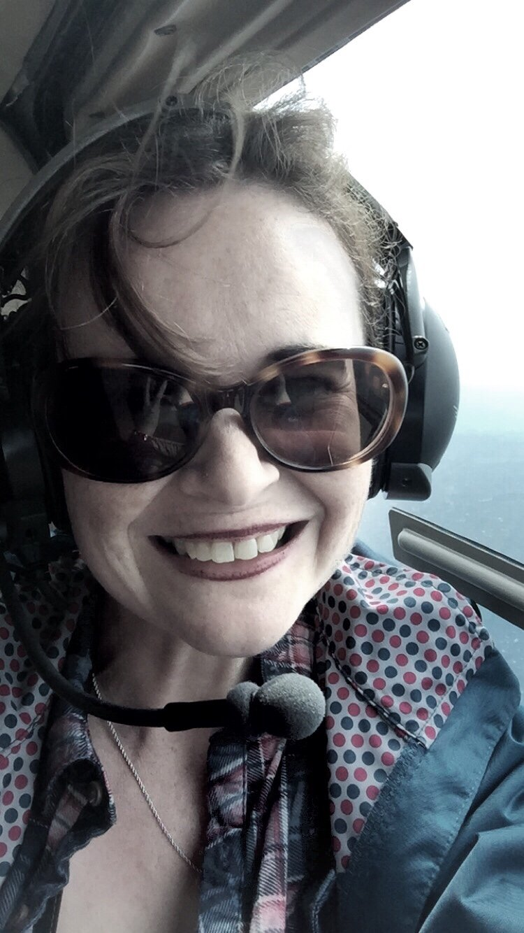 Smiling passenger in a helicopter
