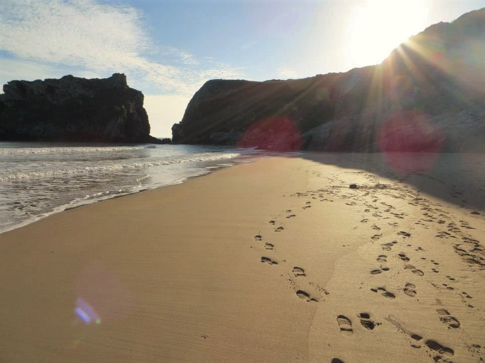 Footprints on beach; Temby, Pembrokeshire, Wales