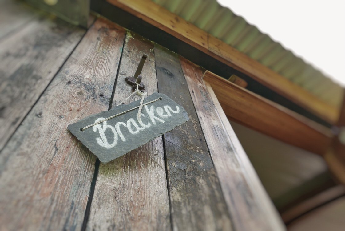 A handmade doorsign on a shepherds hut