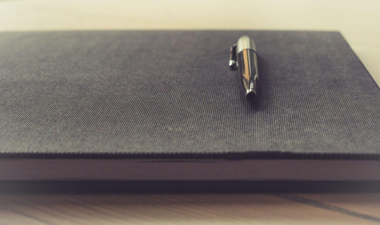 Pen on grey notebook