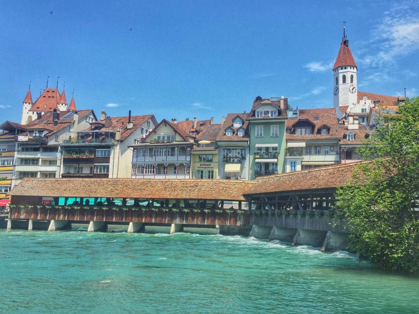 City of Thun, Switzerland, medieval church and wooden bridge