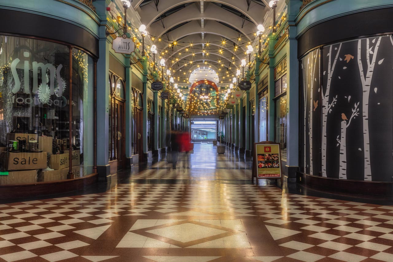 Shopping arcade with tiled floor and chandalier lighting