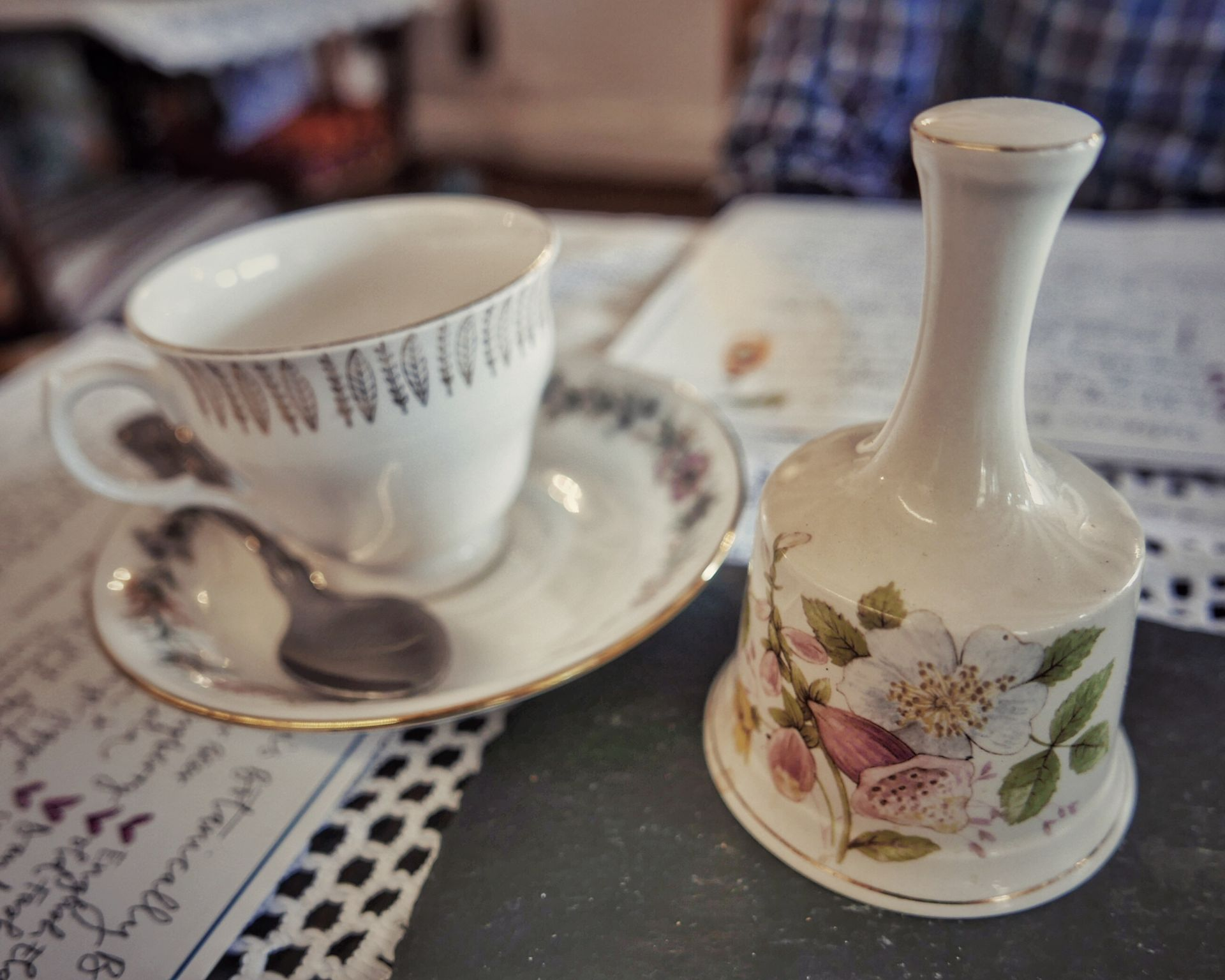 China tea cup and bell in a vintage tea room